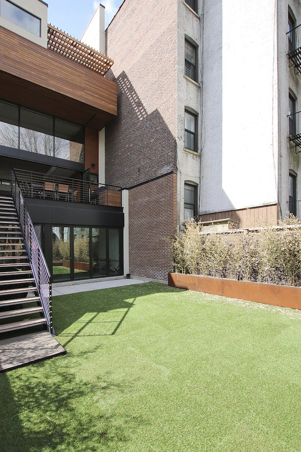 Backyard in Artificial Turf Tiles for Maintenance-Free, Forever-Green Lawn