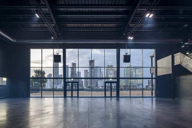 The rear glazing looks out onto the Thames and the towers of Canary Wharf