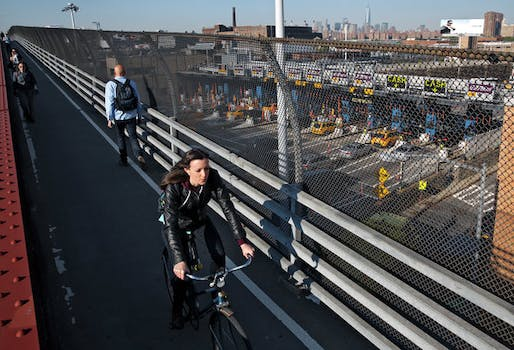 To get to work in Manhattan from Greenpoint, Brooklyn, Dana Johns rides her bike to a subway stop in Long Island City, Queens, locks the bike up and then hops on the 7 train for one stop to Grand Central. Credit Michael Appleton for The New York Times.