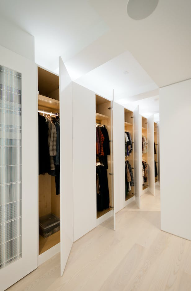 Wall-to-wall Full Height Built-Ins in the Master Suite Provide Efficient Storage
