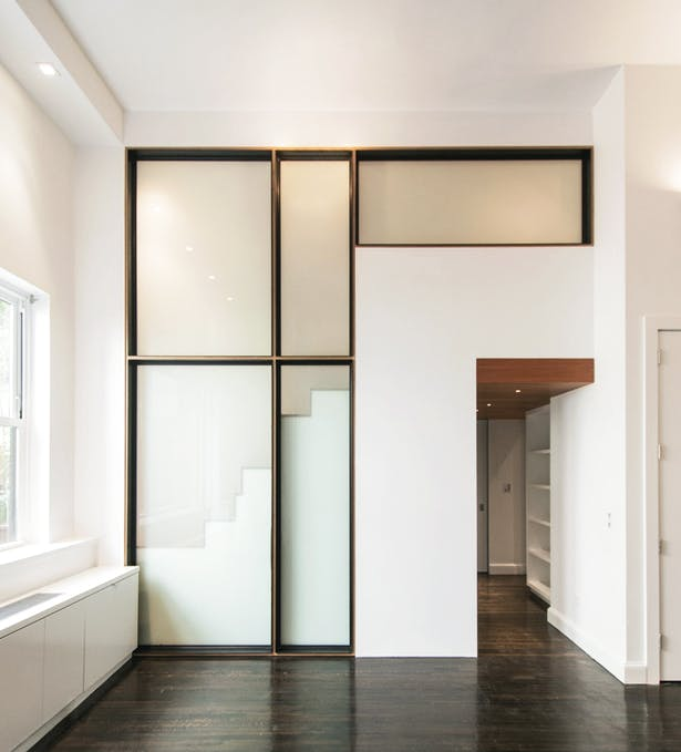 A Simple Yet Artful Composition of Translucent Panels, Baltic Birch, and Black Steel