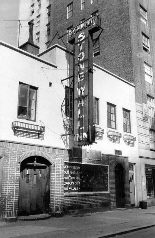 The Stonewall Inn in 1969. The sign in the window reads: 'We homosexuals plead with our people to please help maintain peaceful and quiet conduct on the streets of the Village—Mattachine.' Photo by Diana Davies / New York Public Library, via wikimedia.org