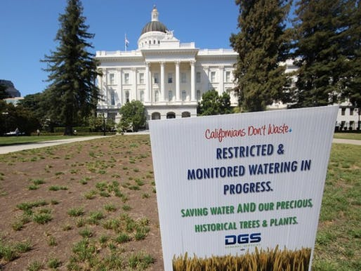 'Restricted & monitored watering in progress' at the California State Capitol in Sacramento. (Image via roam and shoot/Flickr)