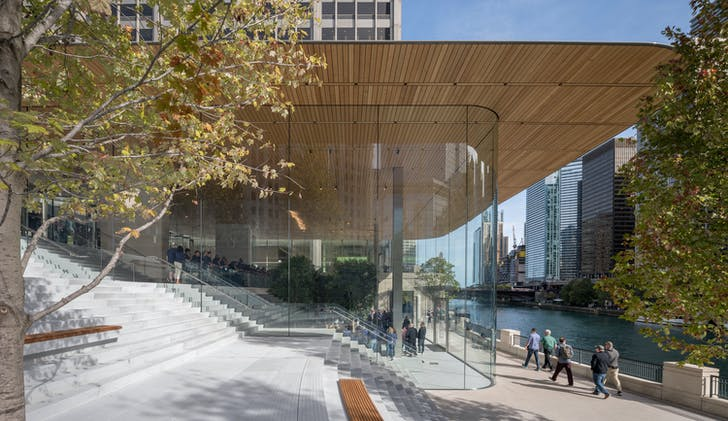 The Chicago Apple Store's new Michigan Avenue address. The new connecting steps pass uninterrupted into the store's interior space. Photo (c) Nigel Young Foster + Partners