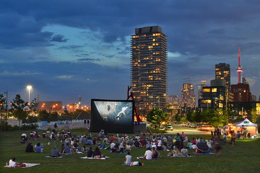 A community movie night on the south lawn at Corktown Common overlooking the downtown skyline. West Don Lands. Toronto, Ontario, Canada. Photo Credit: Nicola Betts.