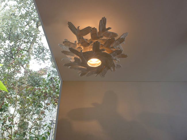 'BIRD IN HAND' shadow playing chandelier