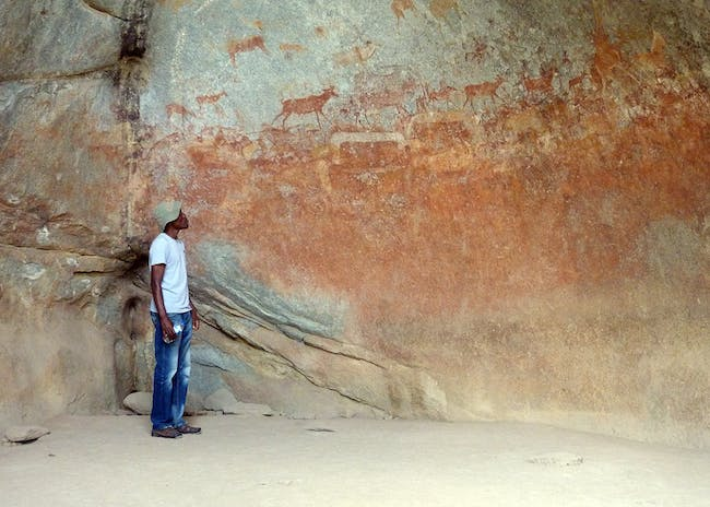 Matobo Hills Cultural Landscape, in Matobo, Matabeleland, Zimbabwe. Rock art at Nswatugi Cave, one of the sites where were extensive research of the paintings has been carried out, 2016