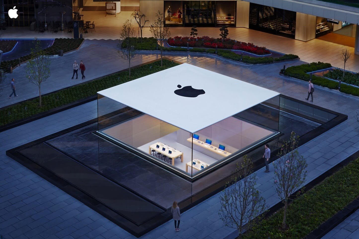 Archinect news articles tagged apple stores istanbuls new ultra minimal apple store showcases a seamess glass box protruding from the ground falaconquin