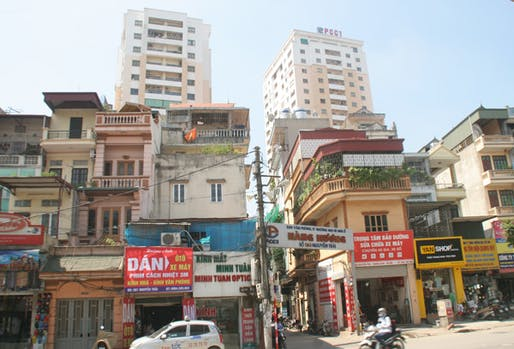 Apartment towers are popping up in Hanoi's network of small alleyways, causing major traffic, infrastructural problems and severe fire danger. (Image via vietnamnet.vn)