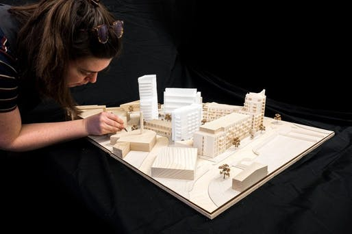 Architectural Assistant Ellie Sampson of Haworth Tompkins working on the Central Middlesex Hospital housing development model. Image courtesy of Fred Howarth/Courtesy of AJ