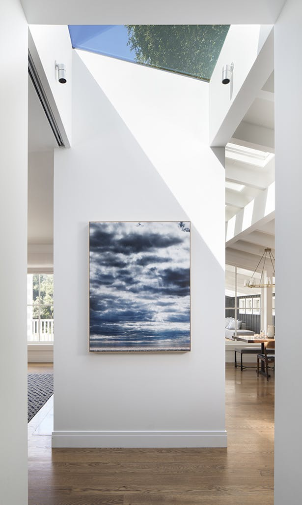 A dividing wall between the living room and kitchen is the perfect showcase for artist Eric Cahan's Sky series print.