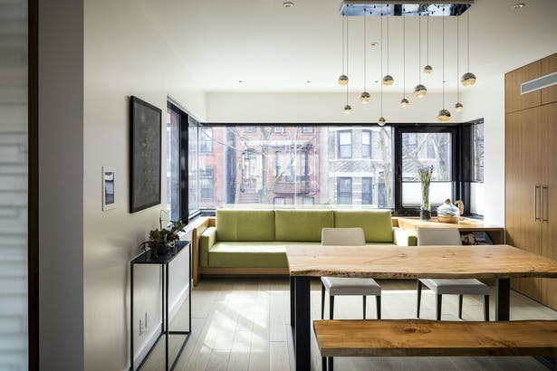 Dining Area with Custom Built-In Sofa Overlooking Street