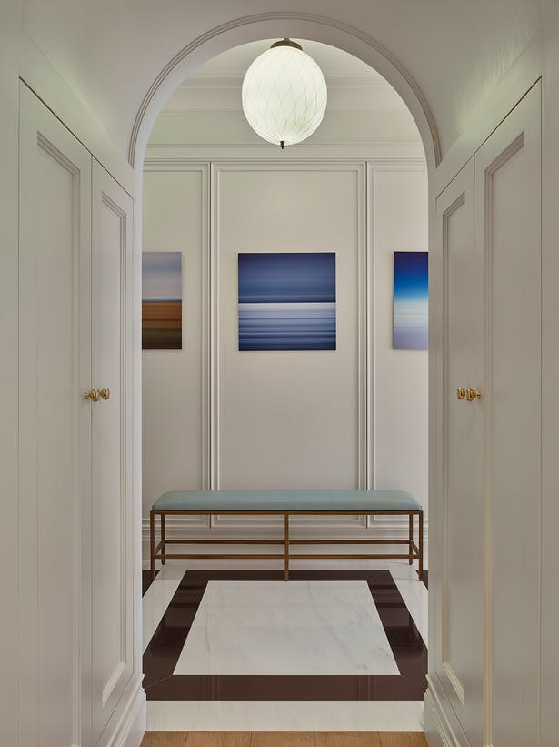 This Landmarked Apartment on Gramercy Park is a historic duplex originally built in 1909. Airy rounded archways can be found throughout the home.