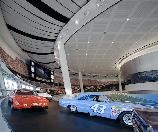 """Glory Road"" exhibit in Great Hall The Great Hall's ramp contains a display of race cars frozen in a moment from a race, capturing in another way the speed and spectacle that is the essence of the sport."