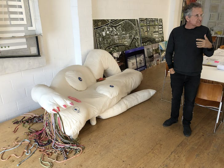 Michael with an art piece produced by one of Lehrer Architects' artists in residence