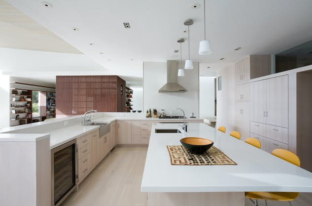 The kitchen is meant to be minimal, almost like furniture, and a long island also acts as an informal eating area.