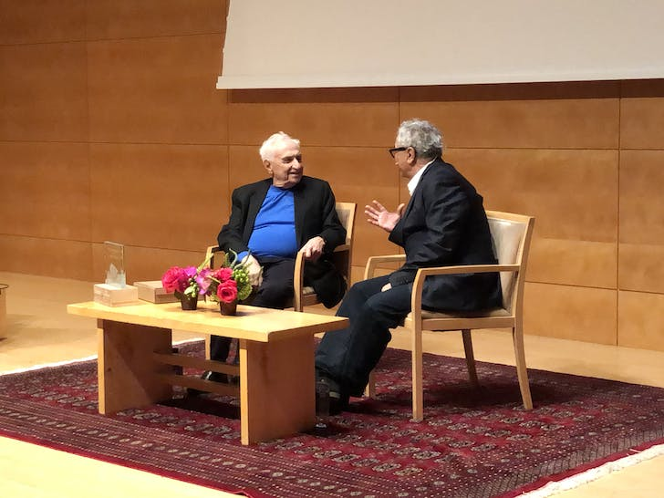 Frank Gehry and Orhan Ayyüce in conversation. Photo by Paul Petrunia