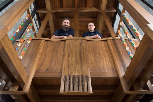 Master craftsmen Angus Johnston and Martins Cirulis of Laurence McIntosh in the Mackintosh Library prototype. Photo © McAteer photo.