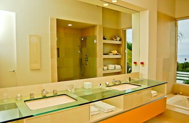 Master bathroom features waterjet cut glass top.