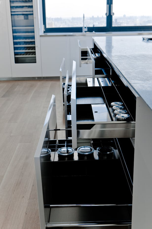 GLAM Kitchen - different storage solutions to maintain the Kitchen area clean and sleek.