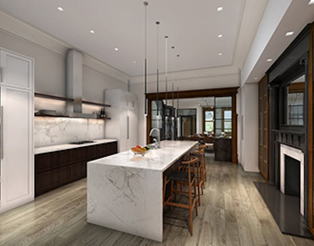 The large kitchen space is connected by sliding steel doors to the living room, allowing easy access while entertaining guests.