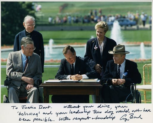"Image courtesy of <a href=https://commons.wikimedia.org/wiki/File:Photo_of_President_George_H._W._Bush_signing_the_Americans_with_Disabilities_Act_inscribed_to_Justin_Dart,_Jr.,_1990.jpg""> National Museum of American History Smithsonian Institution </a>"