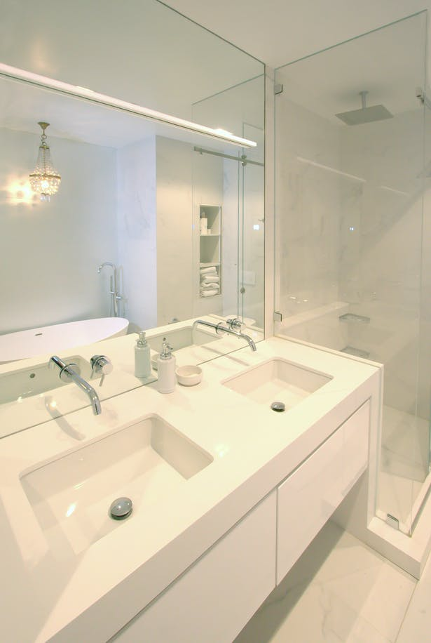 New primary bathroom incorporates porcelain, quartzite and acid-etched mirror for a serene, restful experience