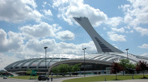 The Montreal Olympic Stadium ranks #1 in percentage over-budget, overtaking the initial estimate by nearly 2000%. Image via Wikipedia.