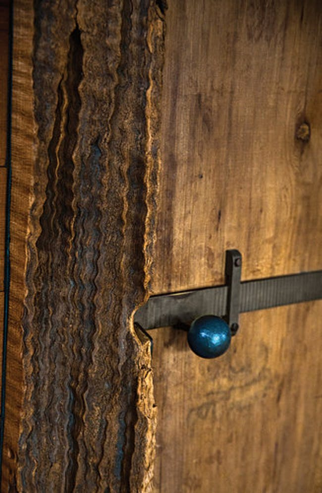 The doorknob to the master bedroom was cast from Blunk's collection of melted-down lead wine pulls. Credit Lisa Eisner
