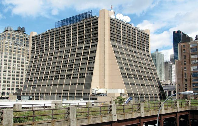'During the 1980s, the building's hard beauty was neutered when its external structural elements were painted beige and its fill-in wall panels clad in brown-colored metal siding.' Image courtesy of REX.