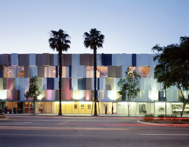 Award-winning façade serves as a rain screen, insulation, and acoustic diffuser for the city's main artery.