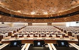 Designed by PEIA Associati, WOOD-SKIN covers UN assembly hall ceiling to resemble sand dune waves