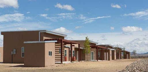 East view of Wa-Di Housing development down shared community space, looking towards the Cerrillos Hills. Photo Credit: AOS Architects