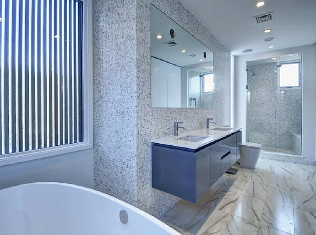 The bathroom features a large soaking tup and separate walk-in shower.