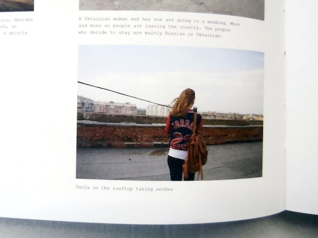 Pages 126 detail. Julia Autz' photo essay Transnistria. Tanja on the rooftop taking selfies.