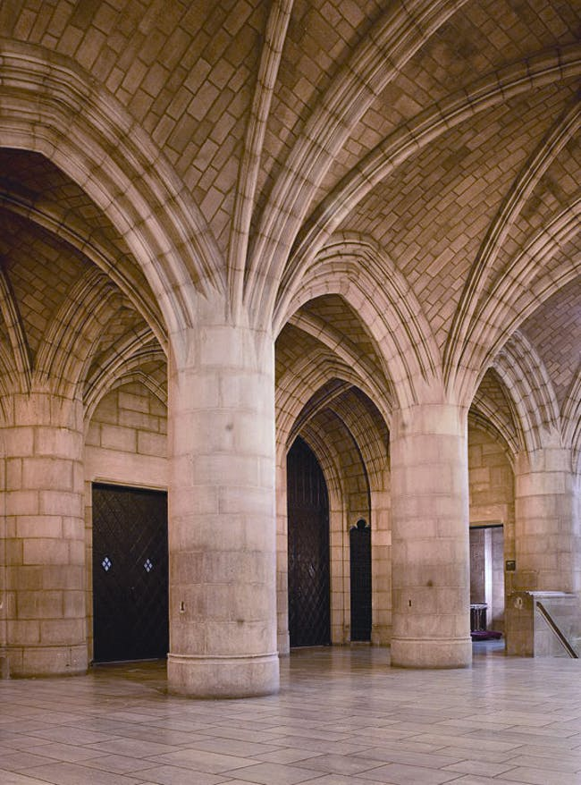 Entrance vaults at the Riverside Church in Manhattan by the Guastavino Company. The Guastavino Company was able to integrate its vaulting into the steel framing, so that the loads were shared between the two systems. Though this made the vaulting seem decorative rather than essential, the vaulting was in fact load bearing and part of the building's structural system. Photo © Michael Freeman, Courtesy of the Museum of the City of New York