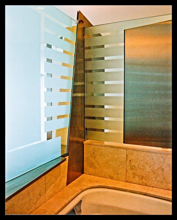 Glass, st. steel detail @Back of sink, bed head board, tub area.