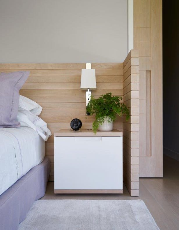 Bleached walnut headboard with floating night stands. Joshua McHugh Photography