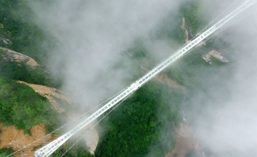 Overwhelmed by the unexpected number of visitors, the Zhangjiajie Grand Canyon glass bridge needs a little...break. (Image via bbr.com)