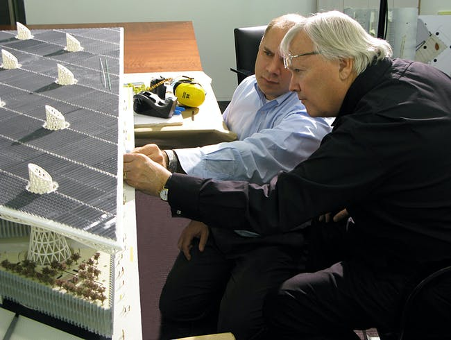 Adrian Smith and Gordon Gill with Masdar HQ model © AS+GG