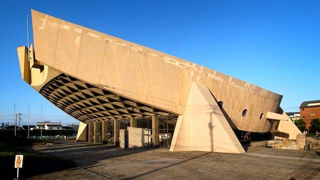 Kagawa Prefectural Gymnasium, in Takamatsu, Kagawa Prefecture, Japan. The Kagawa Prefectural Gymnasium, seen from the southwest, was designed to evoke the form of a traditional Japanese wooden barge, 2014. Photo: Noriyuki Kawanishi