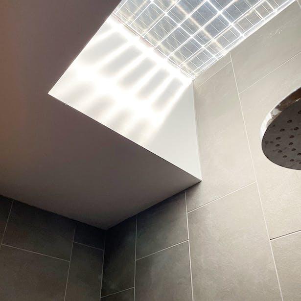 Bifacial panel over shower skylight casting shadow