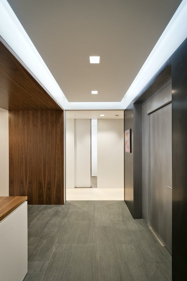 Elevator Entry Wall Clad in Stainless and Black Steel