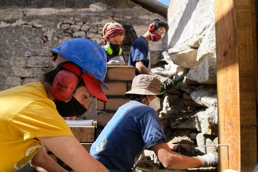 Students and mentors getting hands-on construction experience on site