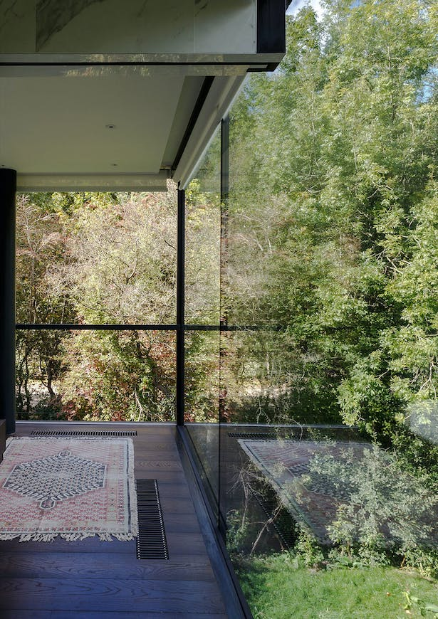 Every room boosts two glass walls, allowing the light to flow freely throughout the property. Image by mariashot.photo