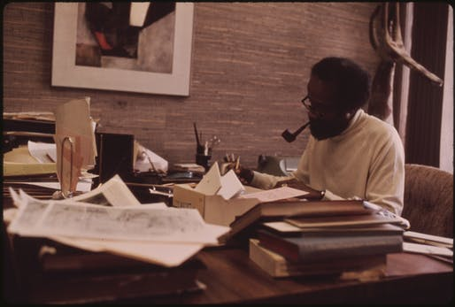 Photograph of Ebony editor Lerone Bennett working in his office at the Johnson Publishing Company headquarters. Image courtesy of John H. White.