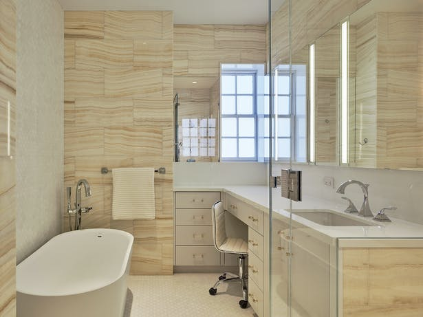 Modern touches extend to the apartment's four full baths. Each includes bold design statements, including floor-to-ceiling onyx tiles and full slabs of Zebrino marble.