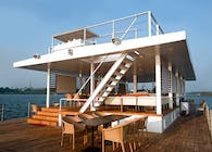 A modern floating barge designed to be used as a restaurant / party joint in Goa, India