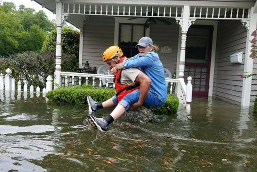 A Texas National Guardsman carries a resident from her flooded home following Hurricane Harvey in Houston, Aug. 27, 2017. Army National Guard photo by Lt. Zachary West