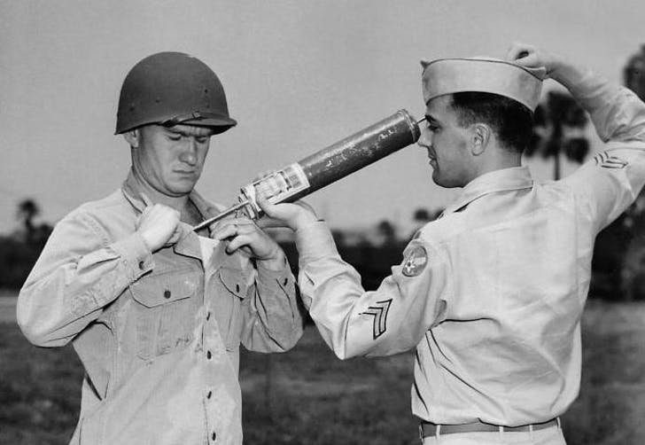 A U.S. soldier demonstrating how to apply DDT directly to the human body. Credit: WikiCommons